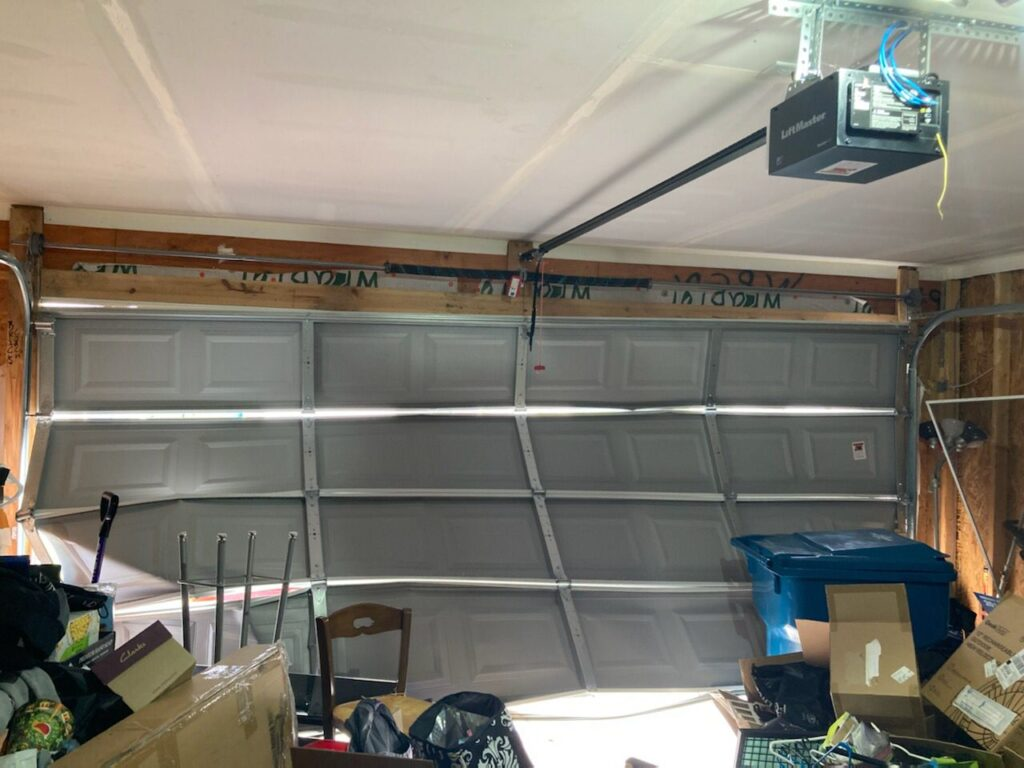 Inside of a garage with broken door